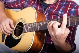 Solo Guitarist Plays The Part On The Electric Guitar. Close-up.