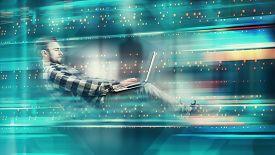 Man Working On Laptop In Futuristic Digital Backgroud. High Speed Browsing .