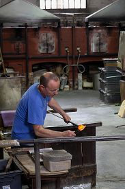 Venice,italy -  april 15, 2018: Craftman Working At A Traditional Glass Factory In Murano Islan