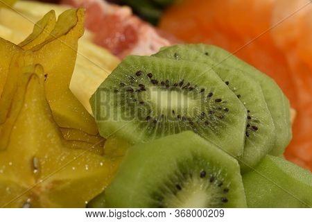 Macro Shot Of A Kiwi Slice Sliced Kiwi Macro.  Green, Slice, Kiwi, Macro