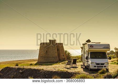 Mojacar Spain - January 5, 2020: Rv Caravan At Historic Castle Of Macenas On Mojacar Beach, Spanish