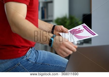 Guy In Jeans Analyzes Financial Report Chart. Statistics For Given Scenarios Lead Generator. Busines