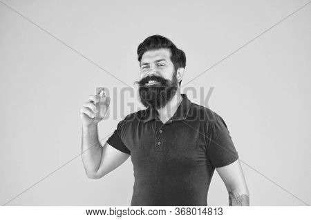 Lotion And Spray. Perfumery Products Concept. Man Well Groomed Bearded Handsome Hold Bottle Perfume.