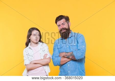 Loving Their Casual Look. Small Child And Bearded Man In Casual Style. Father And Little Daughter Ye