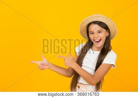 I Like Summer. Happy Child Pointing At Yellow Background. Little Girl With Pointing Gesture. Index F