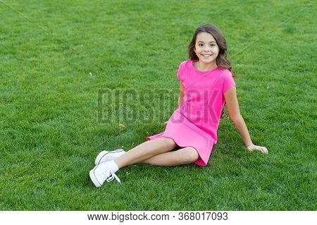 Green Summer. Little Child Sit On Green Grass. Small Girl Enjoy Summer Day. Happy Summer Holidays. F