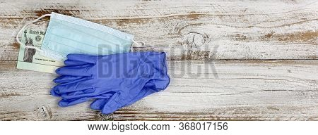 Economic Impact Stimulus Check On White Wooden Desktop With Personal Protection Equipment