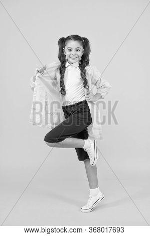 Waterproof Concept. Small Schoolgirl Wear Water Resistant Clothes For Rainy Day. Cute Schoolgirl Fee