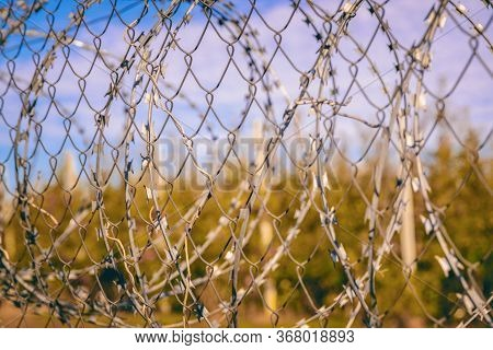 Barbed Wire In The Outdoor, The Texture Of The Barbed Wire, The Concept Of Prohibition Or Deprivatio