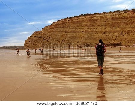 Lagos/portugal - August 12, 2015: Children Playing And People Walking At Porto De Mos Beach, At Suns