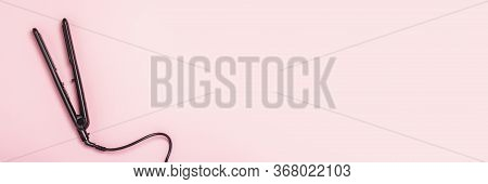 Hair Straightener On A Pink Background. Concept Of Hair Care, Hairstyle, Beauty Salon, Hairdresser.