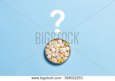 Pills And Question Mark On A Blue Background. Insomnia, A Choice Of Drugs, Vitamins. Flat Lay, Top V