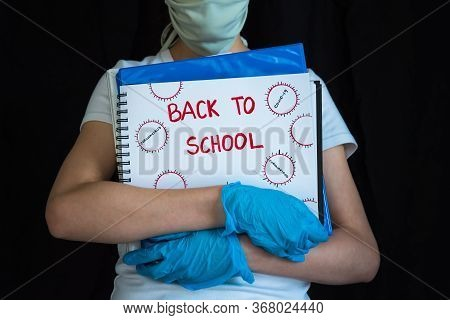 Student Wearing Face Mask And Gloves, Holding School Books. Concept Of Reopening Schools During Covi