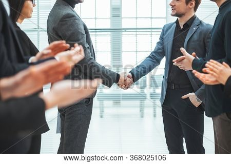 Business Team Applauding At A Meeting With Business Partners