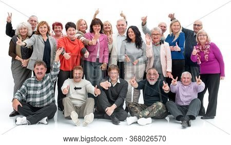 Group of happy elderly people standing and sitting isolated over a white background