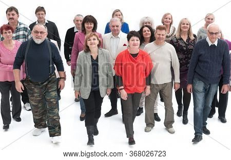 Casual group of people walking isolated over a white background
