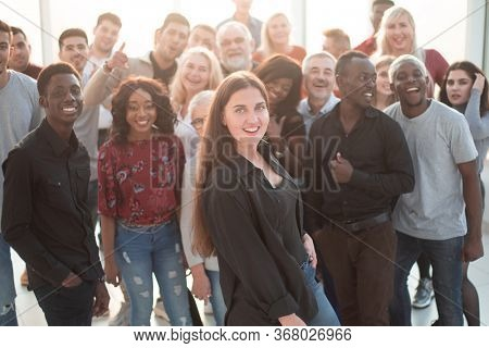 confident young woman standing in front of a group of her friends