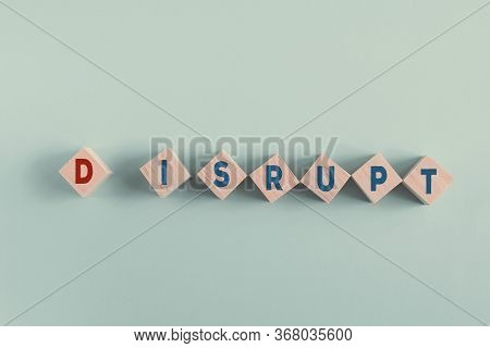 Wooden Blocks With Word Disrupt, Disruptive Innovation Way Of Business Concept