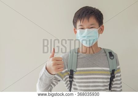 Asian Preteen Tween Teen Student  Boy Wearing Mask And Giving Thumb Up, School Reopening, Return Bac
