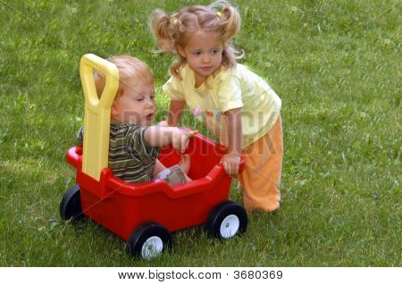 Boy and girl with wagon