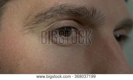 High Quality Close-up Of A Man Eye Blinking During The Conversation