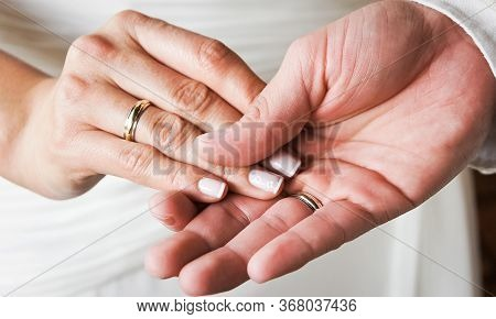 Newly Married Hands With Gold Rings, White Dress, Closed Plane