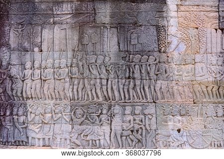 Stone Carvings On The Walls Of The Bayon Temple In Angkor Thom
