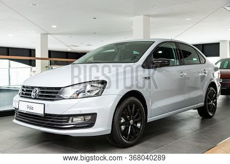 Novosibirsk/ Russia - March  03, 2020 White Volkswagen Polo  Front View.  Modern  Sedan Made In Russ