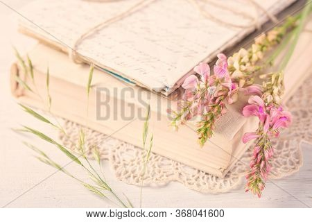 Old book and flowers on the table
