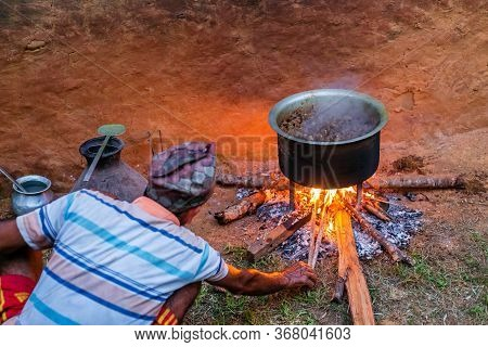 Gorkha,nepal - October 6,2019: Old Man Cooking Mutton Curry In The Rural Village Of Nepal. Mutton Cu