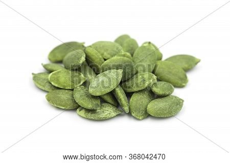 Organic Roasted Pumpkin Seed Or Pepita On White Isolated Background, Closeup Side View. Pumpkin Seed