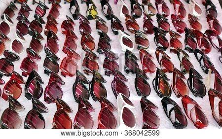 An Outdoor Vendor Sells Cheap No-brand Sunglasses.
