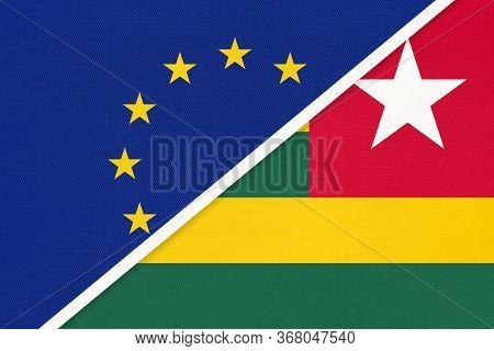 European Union Or Eu And Togo Or Togolese Republic National Flag From Textile. Symbol Of The Council