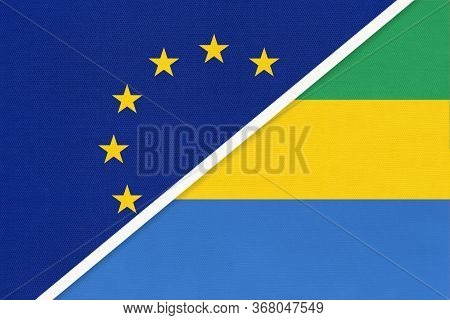 European Union Or Eu And Gabon Or Gabonese Republic National Flag From Textile. Symbol Of The Counci