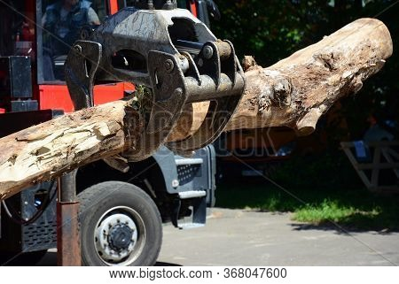 A Close-up On A Modern Red Tractor Forest Equipment, Timber Loader, Knuckleboom Log Loader With A La