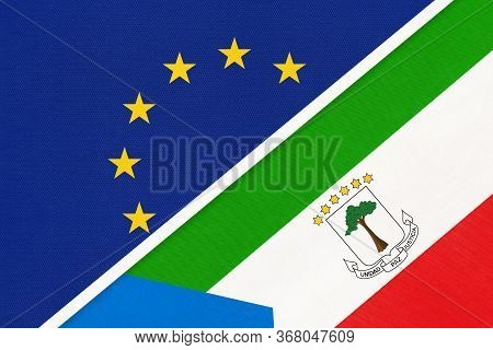European Union Or Eu And Equatorial Guinea National Flag From Textile. Symbol Of The Council Of Euro