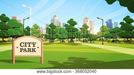 Sign Board In City Park Beautiful Summer Day Skyline Skyskraper Buildings Sunrise Cityscape Backgrou