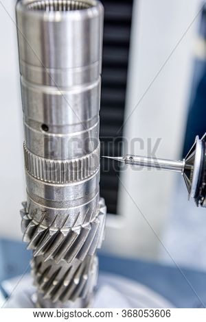 The Coordinate Measuring Machine Cmm Measures The Measures A Metal Shaft