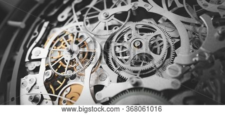 Gears and cogs in clockwork watch mechanism. Craft and precision - elegant detailed stainless steel and metal. 3D illustration