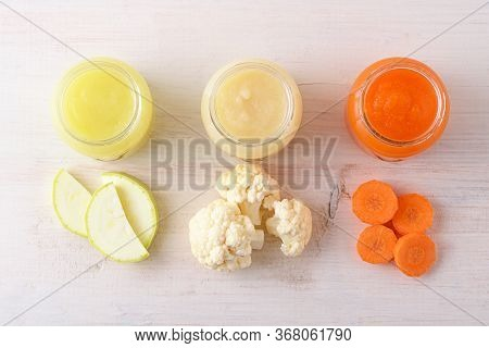 Top View Children's Vegetable Food On White Background, Natural Homemade Mashed Zucchini Cauliflower