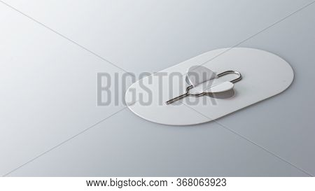 Sim Card Tools, Eject Pin Sim Card Tray For Smartphones Isolated On Gray Background. Selective Focus