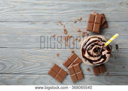 Glass Of Chocolate Milkshake On Wooden Table. Summer Drink
