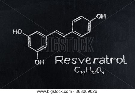 Black Chalkboard With The Chemical Formula Of Resveratrol.