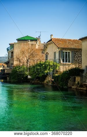 Vertical View Of Old Stone Houses In Medieval Village L'isle-sur-sorgue, Vaucluse, Provence, France.