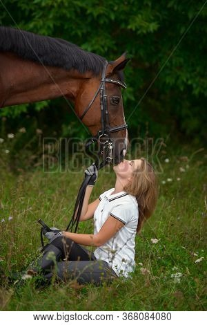 Beautiful Young Girl Rider And Her Horse