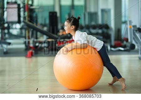 Asian Child Girl With Gymnastic Ball