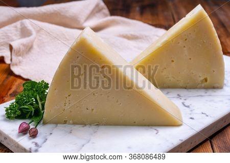 Pieces Of Matured Pecorino Romano Italian Cheese Made From Sheep Milk In Lazio, Sardinia Or Tuscany
