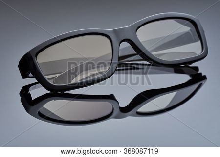 Choral Plastic Glasses For The Cinema Lie On The Reflecting Surface. Macro Photo
