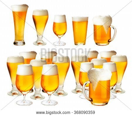 Glasses Of Beer With Froth Isolated On A White Background