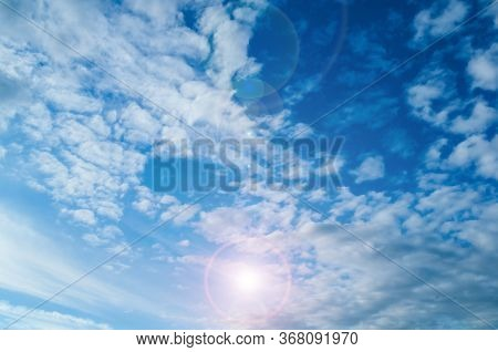 Sunset sky background. Sunset clouds lit by evening soft sunlight. Vast sky landscape panoramic scene, bright sunset sky view. Vast sky landscape, colorful sky background. Blue sky panorama, cloudy sky view